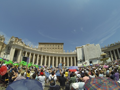 Watching Pope Francis speak at St. Peter's Square - he's at the top right of the building